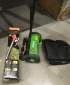 A FLYMO sabre cut cordless hedge trimmer (still packaged) and a Handy manual cylinder lawn mower