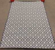 White and blue patterned rug,