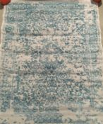 A grey and green vintage patterned rug - 158cm x 220cm