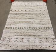 Beige and multi coloured speckled rug,