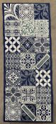 Blue and white patterned rug,