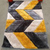 Blazon rug, black, grey, white and mustard,