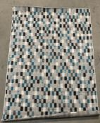 Grey, blue and green checked pattern rug,