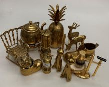 Fifteen pieces of brassware including two miniature miner's lamps, ornaments, bowls, etc.
