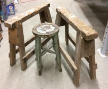 Two wooden trestles and a wooden stool