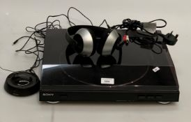 A Sony PS-LX300HSB stereo turntable system and a pair of Philips SBC HC8445 wireless headphones (2)