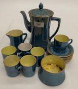 A Carlton blue glazed porcelain fifteen piece coffee set (one cup white glazed internally)