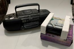 A Harvard car radio/cassette player in non matching Boss box and a Sharp WQ-C060 portable stereo