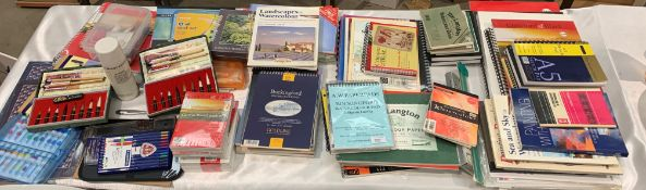 Remaining contents to table top - a quantity of watercolour pads, sketch pads, water colour paper,