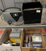 Contents to part of rack and under - box containing assorted music CDs, cordless kettle,