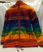 A multi-coloured woollen coat with fleece lining (size M)