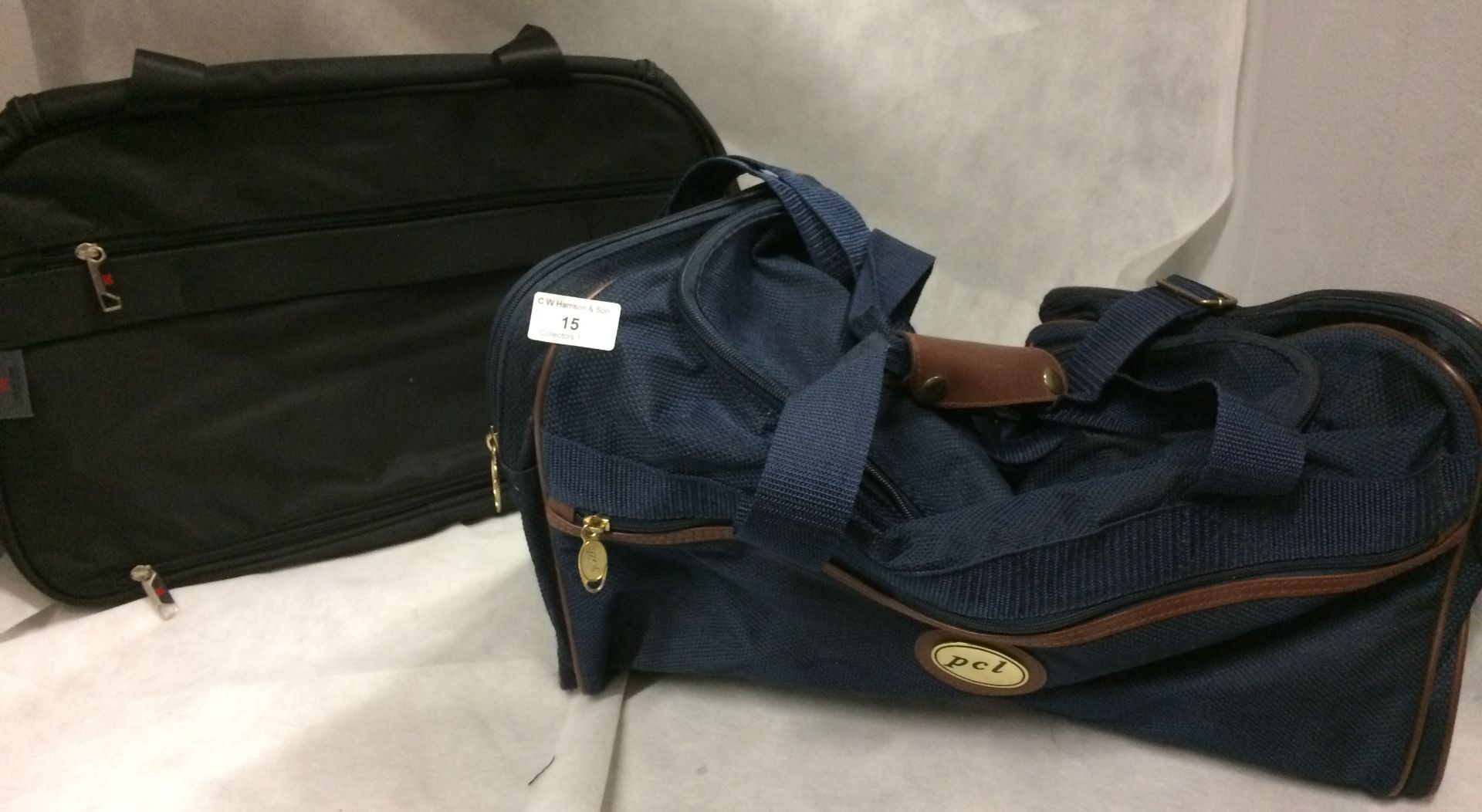 2 x holdalls by PCL and Newlock in black and blue