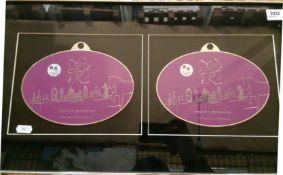 A pair of large oval purple badges inscribed London 2012 - Inspire a Generation,
