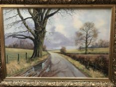 Kevin Walsh, gilt framed oil on canvas 'Country Road in Winter', signed to bottom right,