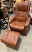 A medium brown reclining armchair with matching lift top stool/side table