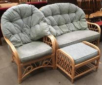 A bamboo framed three piece conservatory suite comprising two seater settee,