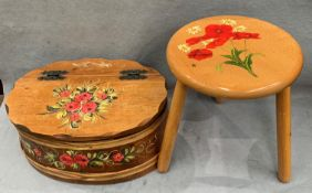 A three legged wood stool with floral pattern to top and a floral pattern painted wood box with