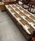 "A 1960s 2'6"" teak framed bed with brown"
