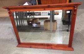A Ducal pine framed wall mirror,