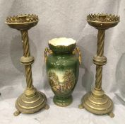 A pair of brass spiral column candlesticks on paw feet, each 47cm high,