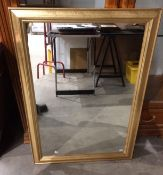 A Jazz gold coloured framed wall mirror,