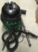 A Numatic QVE370-2 tub vacuum cleaner complete with hose Further Information