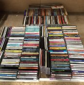 Contents to three white lids - approximately 300 assorted CDs and CD box sets featuring music from