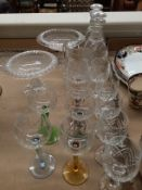 Six coloured stem wine glasses and five other wine glasses, two pedestal fruit bowls,