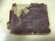 An autograph book, badly distressed,