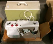 A New Home model 676 240v sewing machine complete with foot pedal and carry case