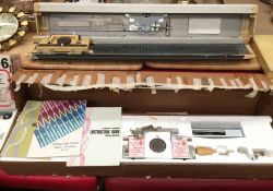 An Empisal Knitmaster portable chunky knitter model no: 150, serial no: 159678N,