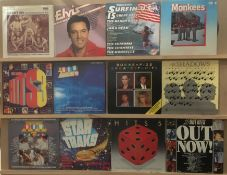 Contents to brown vinyl case, 34 assorted LPs - Elvis Presley, The Monkees, Shadows, compilation,