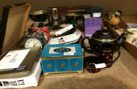 Contents to part of rack - old ashtrays, alarm clock, a pair of brass and green metal scales, etc.