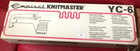 An Empisal Knitmaster YC-6 single and double bed colour changer knitting machine - boxed