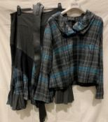 Lisa Campione, a blue and grey jacket with matching belted skirt (unlined), European size 46,