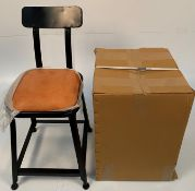 An Industrial UPH low stools with metal back - black metal frames