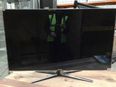 A Samsung UE46D6750WK television complete with remote control