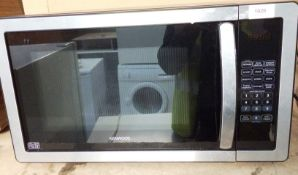 A Kenwood K25MSS11 microwave appliance