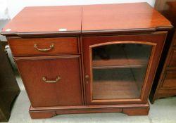 A mahogany finish two door (one glazed),