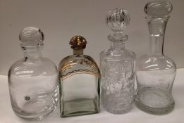 Four glass decanters