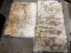 Two sheepskin style rugs one 160 x 80cm and one 110 x 80cm