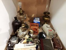 Contents to tray two brass and glass oil lamps, wall light, brown bottle, stoneware bed warmer,