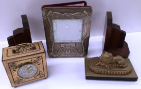 Four items a Skandetui Malmo Design Philipp Swedish decorated mantel clock, pair of book ends,