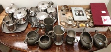 Contents to part table top two stainless steel tea services, pewter tankards and bowls,