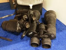 A pair of Zennox 12-36x70 zoom binoculars (strap broken) and a pair of Super Zenith 10x50 field 5°