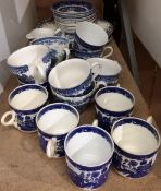 Twenty eight pieces of blue and white and willow pattern tea cups and saucers etc.