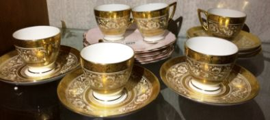 Six Minton gold patterned cups and saucers and six English bone china pink plates with gilt rims