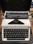 An Olympia International portable typewriter in case