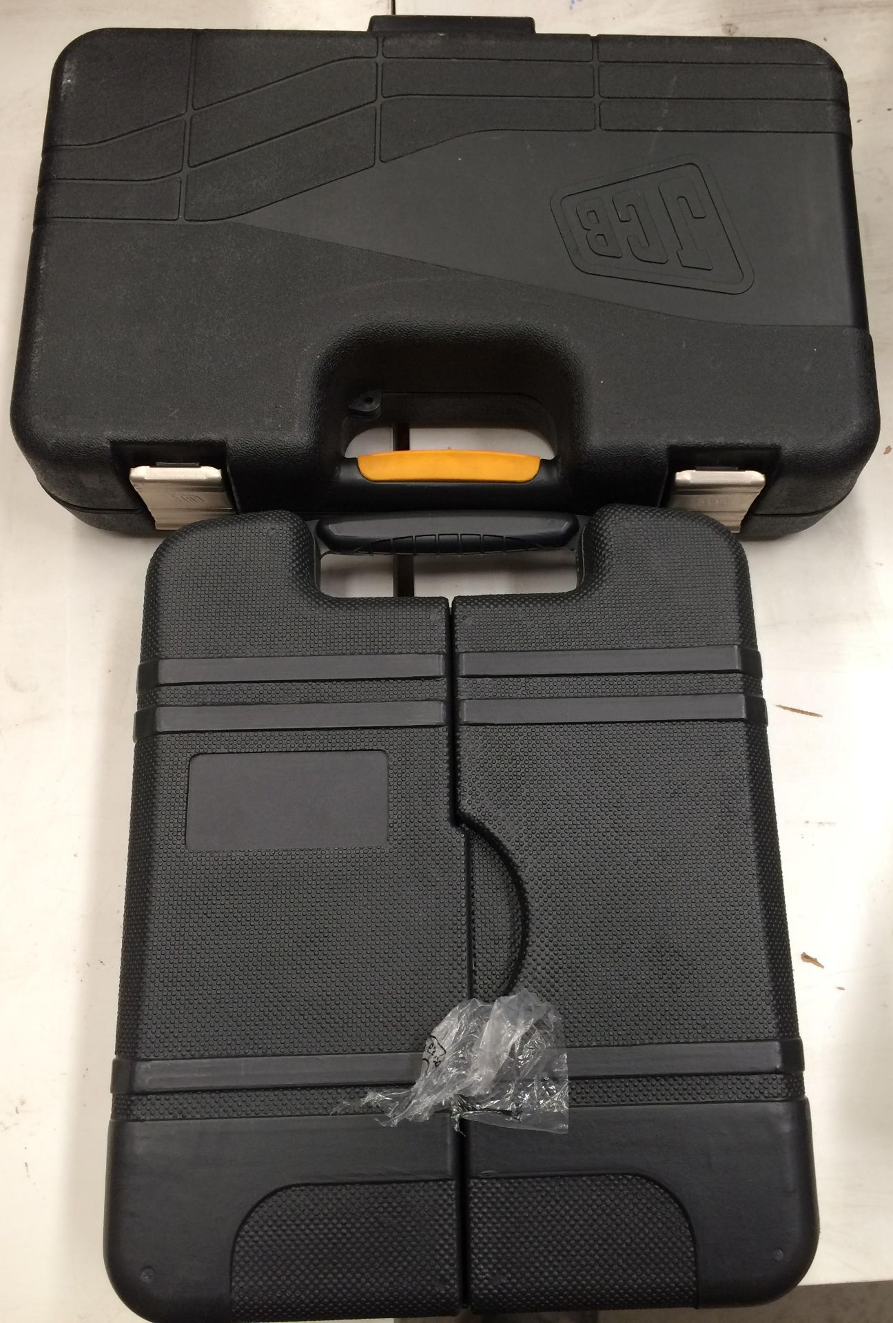 Two assorted tool kit sets by JCB etc.