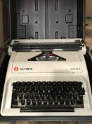 Olympia Carina 2 typewriter in black carrying case